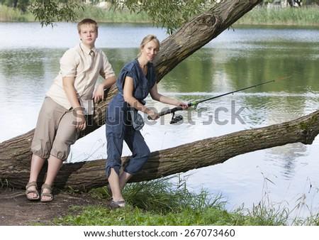 Young people on fishing. - stock photo