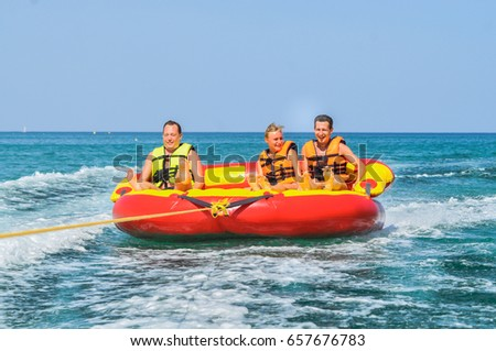 Young people on water attractions during summer vacations. Tunisia. Summer 2014
