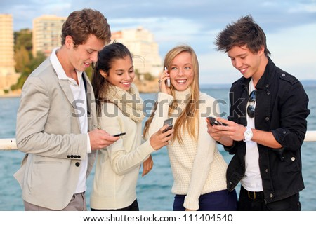 young people or couples with cell or mobile phones - stock photo