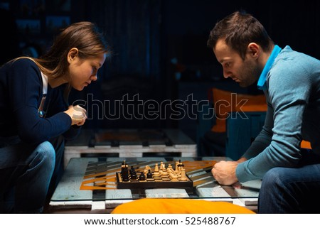 Young people playing chess in the games room