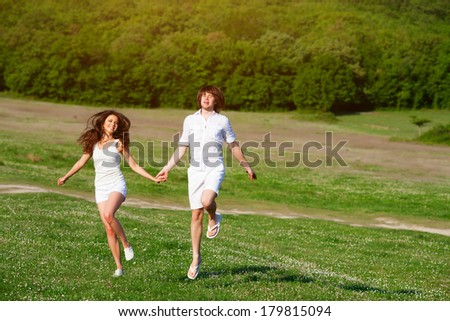 Young people playing on the meadow - stock photo