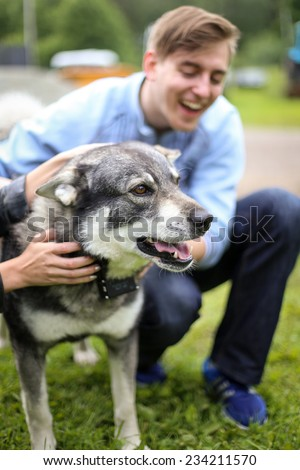 Young people playing with the dog looking happy