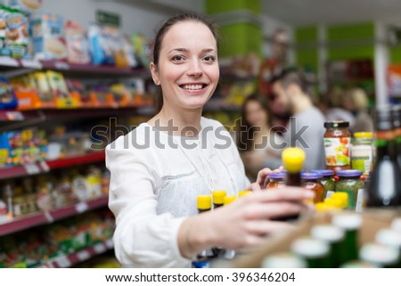 Young people purchasing food for week in the supermarket  - stock photo