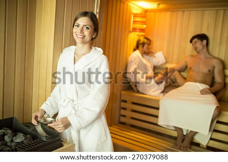 Young people relaxing in sauna - stock photo