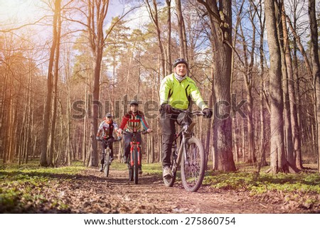 Young people riding bikes - stock photo