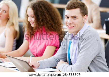 Young people sitting in classroom at lecture
