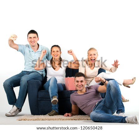 Young people sitting on a sofa and cheering, on white background