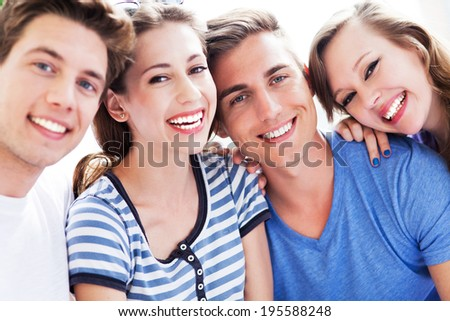 Young people smiling  - stock photo