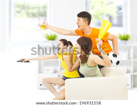 young people so excited to yelling  and while watching soccer game