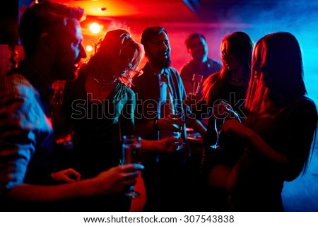 Young people spending time at nightclub - stock photo