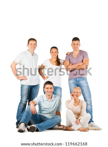 Young people standing and smiling, on white background - stock photo