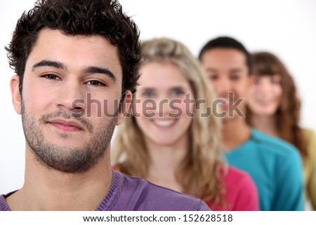 Young people standing in a row - stock photo
