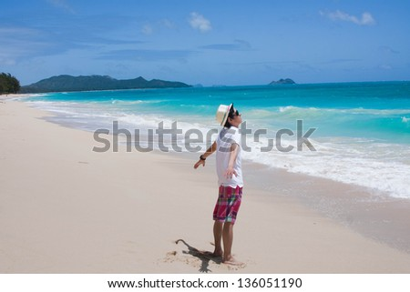 Young people standing on beach in hawaii