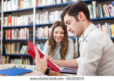 Young people studying in a library - stock photo