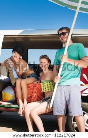 Young people taking break  relaxing in car near the beach - outdoors - stock photo