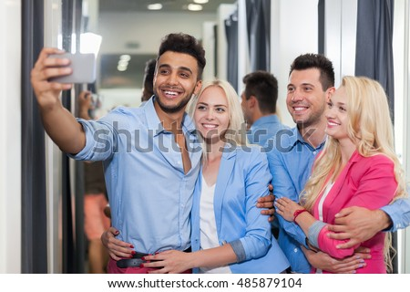 Young People Taking Selfie Photo Fitting Room Fashion Shop, Happy Smiling Couples Customers In Retail Store