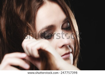 Young people teenage concept - pensive serious woman teenager girl closed eyes portrait on black