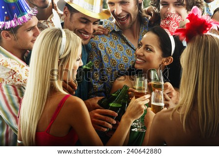 Young People Toasting at New Year Party - stock photo