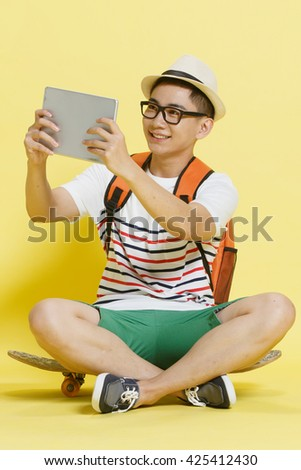 Young people use tablet computers - stock photo