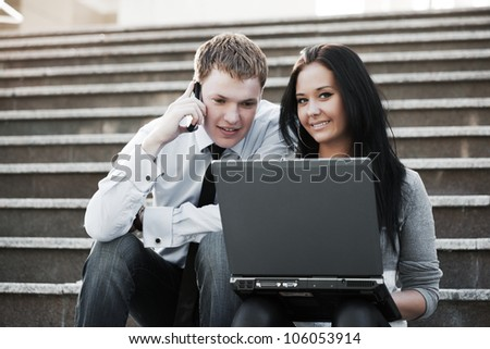 Young people using laptop - stock photo