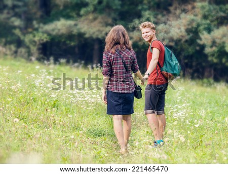 Young people walk outdoor - stock photo