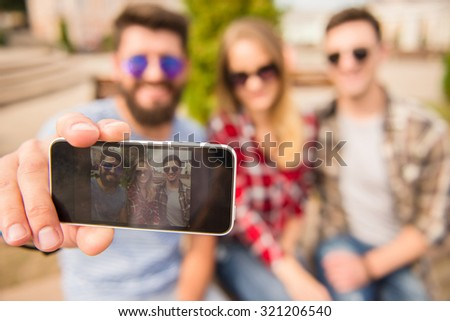 Young people walking outdoors. Sitting in the park