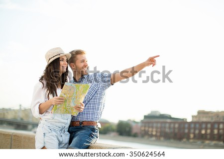 Young people with a map outdoors