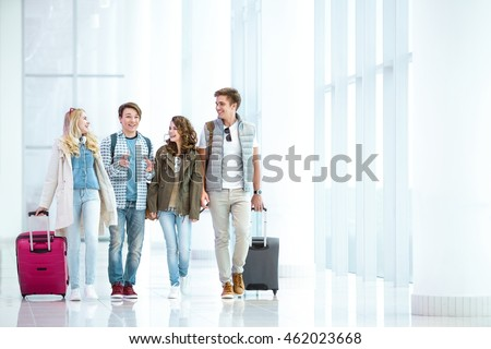 Young people with luggage at the airport