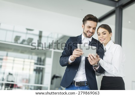 Young people with tablet in the office