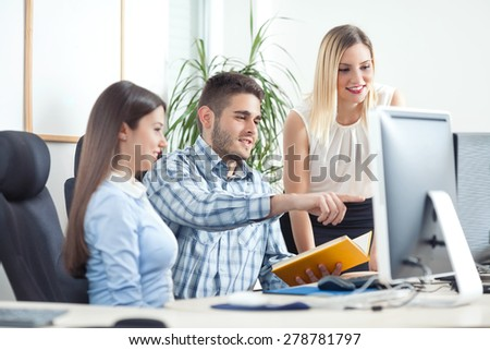 Young people working together in a office