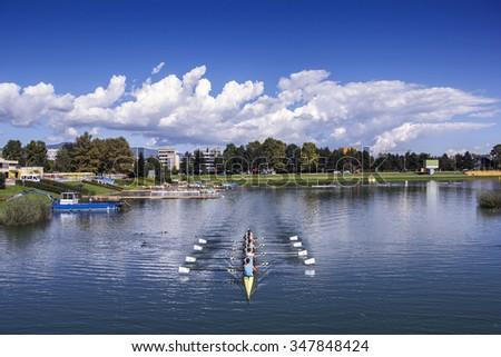 Young pepole training rowing on the lake Jarun in Zagreb, Croatia - stock photo