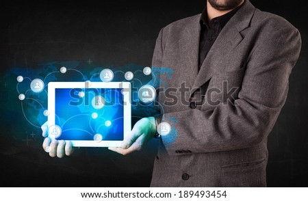 Young person holding talbet with earth communication technology concept