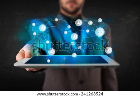 Young person holding talbet with earth communication technology concept - stock photo