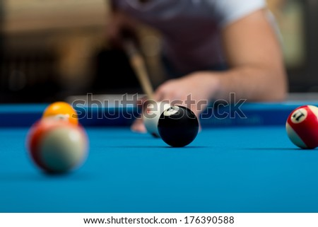 Young Person Playing Snooker - Man Lining To Hit Ball On Pool Table