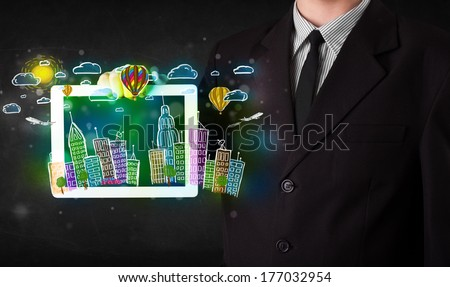 Young person showing tablet with hand drawn colorful cityscape