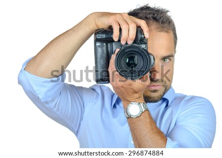 Young photographer at work on white background