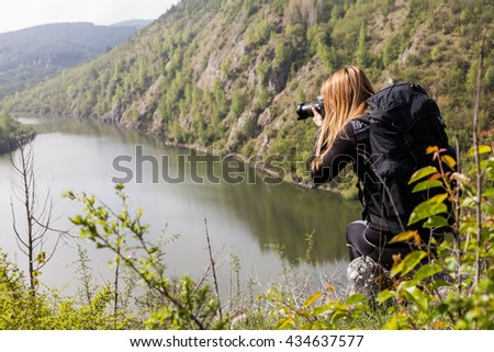 Young photographer shooting nature.
