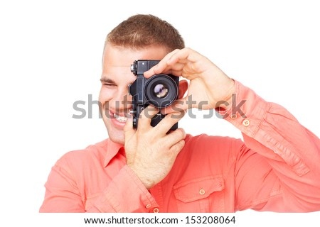 Young photographer taking pictures with his camera isolated on white background