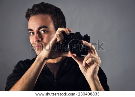 young photographer with analog camera taking photos