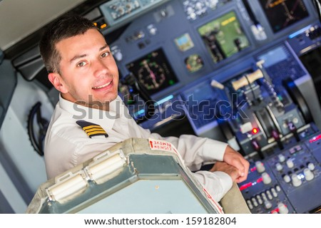 Young Pilot in the Airplane Cockpit