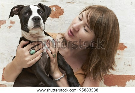 Young Pit Bull puppy with female owner - stock photo