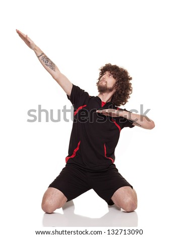 young player with long curly having gaol celebration isolated on white background - stock photo