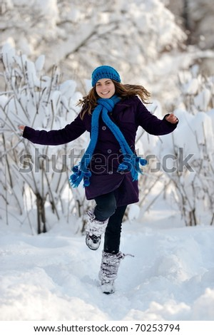 young playful woman outdoor in winter - stock photo