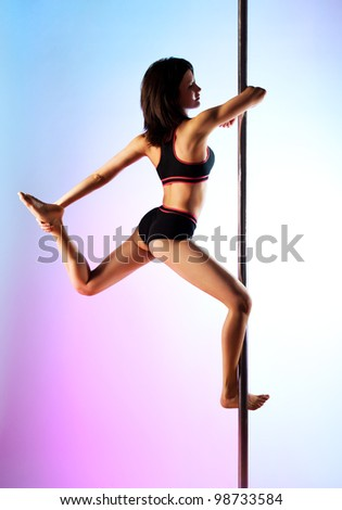 Young pole dance woman on blue and pink background.