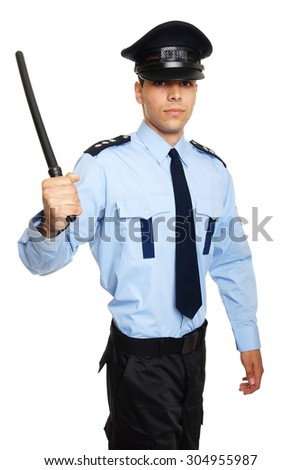 Young policeman holding nightstick in hand