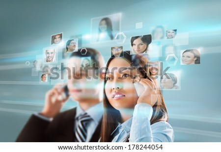 Young positive business man touching virtual button. Editable image - stock photo
