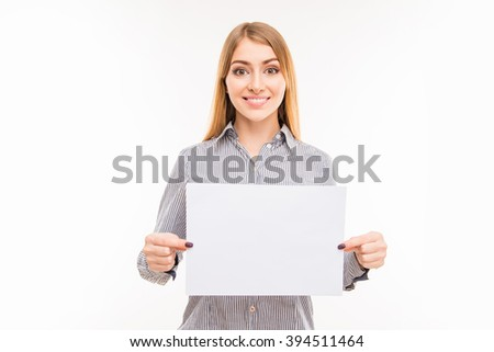 Young positive businesswoman showing blank sheet of paper - stock photo