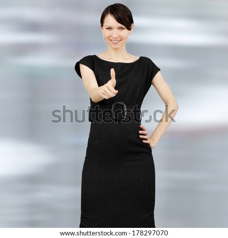 Young positive woman showing ok sign - stock photo