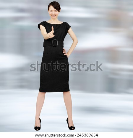 Young positive woman showing ok sign