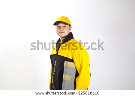 Young postman in a postman uniform - stock photo